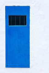 Blue door and white wall