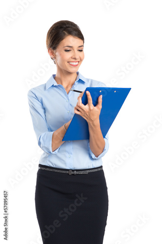 Smiling Businesswoman Writing On Clipboard
