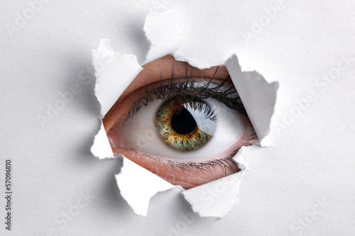 Looking through a hole in white paper