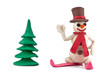 plasticine skiing snowman standing near the Christmas tree