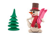 plasticine snowman with skis standing near the Christmas tree
