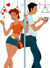 Young couple sexting on a subway
