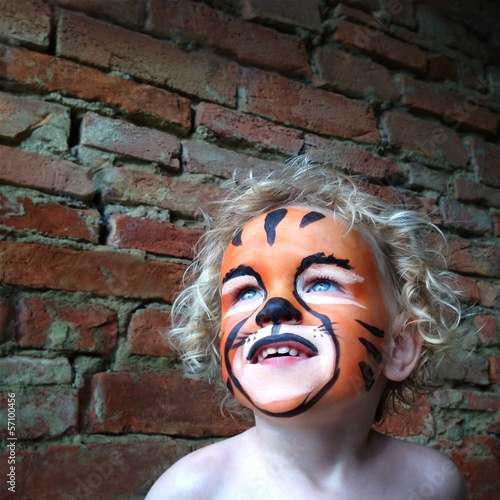 little girl with painted tiger face