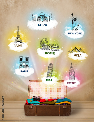 Tourist suitcase with famous landmarks around the world