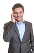 Smart businessman talking at phone