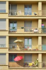 Parasols on the balconies of a tall apartment building in France