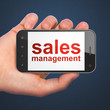 Marketing concept: Sales Management on smartphone