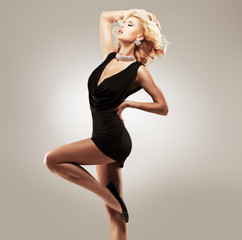 Beautiful female dancer  in black dress