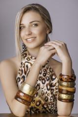 Smiling blonde girl in safari outfit