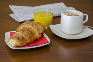 Breakfast with newspaper