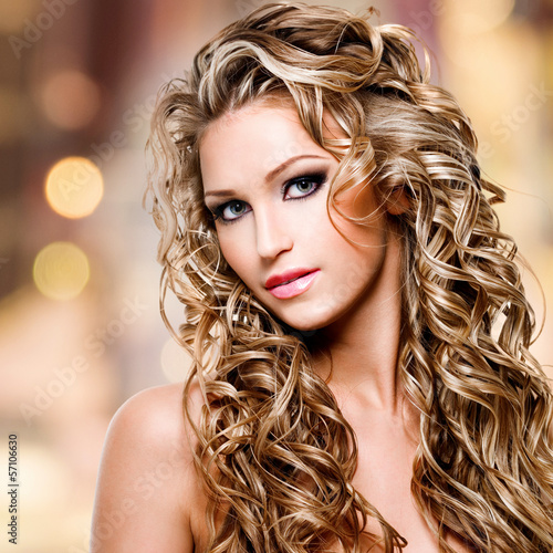 Beautiful woman with long curly hairstyle