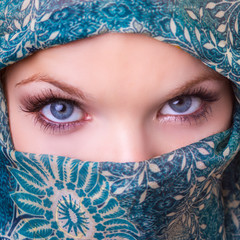 close up portrait of a young woman wearing veil