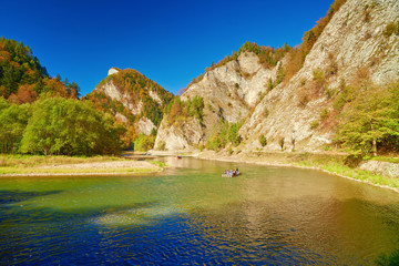 Mountain landscape with The Dunajec River Gorge. Tourists on raf