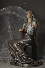 Futuristic princess in silver with bubbles
