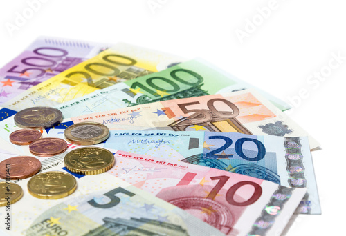 coins and banknotes euro on white - in perspective