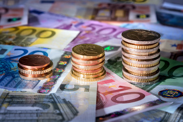 coins chart on euro banknotes