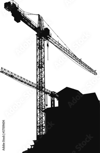 Silhouettes of cranes on building