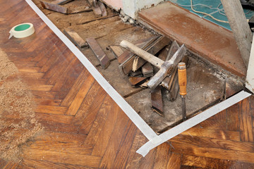 Home renovation parquet floor remove with chisel hammer tool