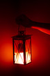 hand holding red lamp