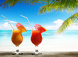 Two fresh juices on beach