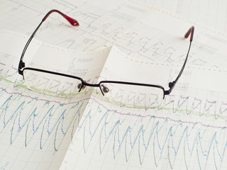 glasses on scientific graph to analysis the results