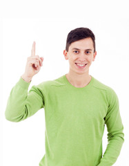 Happy man pointing up, isolated over a white background