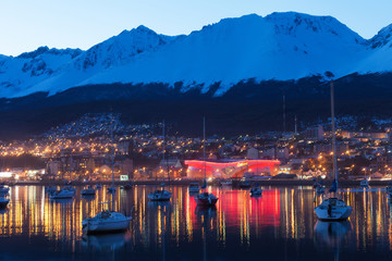 A night view of Ushuaia, Tierra del Fuego. Boats line the harbor