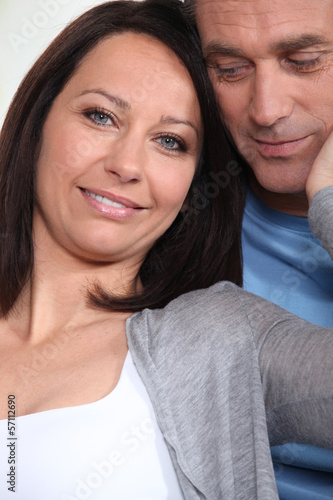 Woman touching husbands face