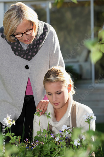 Older and younger women in a garden