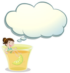 A smiling child swimming on a glass of lemonade