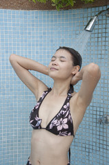 Beautiful Asian woman take a shower.