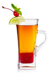Glass of hot fruit tea with fresh mint, lime and cherry berry