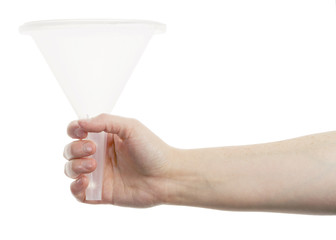 Hand holding white funnel