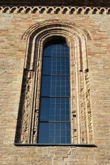 Romanesque cathedral window detail, Crema, Lombardy, Italy