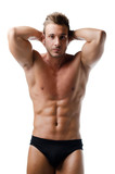 Handsome young muscular man showing ripped abs