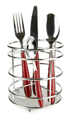 Knife, fork and spoons in metal stand isolated on white