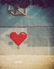 Graffiti heart on the wall in TelAviv street