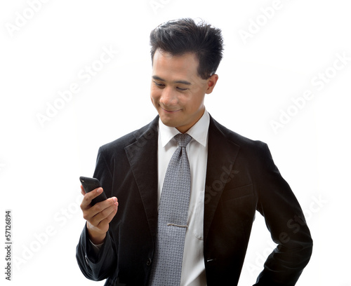Young Asian business man with cellphone