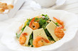 Salad with arugula, shrimp and parmesan cheese.