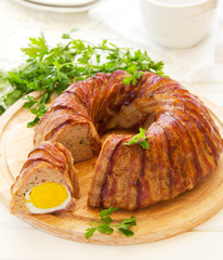 Meat roll with an Easter egg.