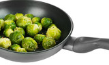Fresh brussels sprouts in pan isolated on white