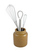 Three metal whisks in a brown ceramic jar