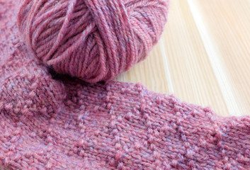 Patterned knitting with ball of pink yarn
