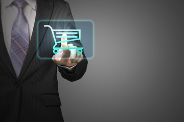 Businessman touch shopping cart icon for purchasing on line in g