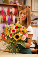 Female Florist is creating a colorful bouquet