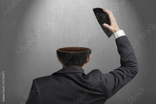 Without any idea inside businessman head in gray concrete wall b