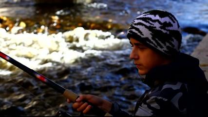 Boy fishing near river in autumn episode 1