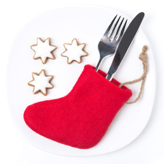 Christmas table setting with red boots and cookies, isolated