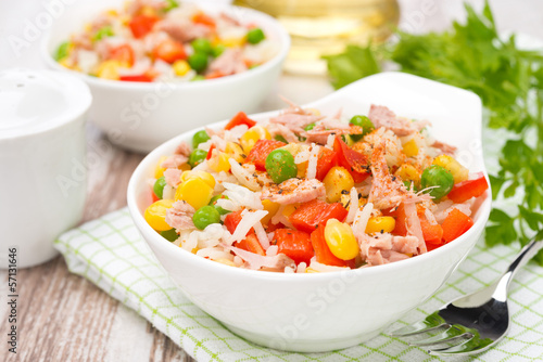 colorful salad with corn, green peas, rice, red pepper and tuna