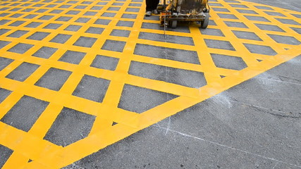 labor use small machine painting line on road